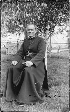 Priest sitting outside