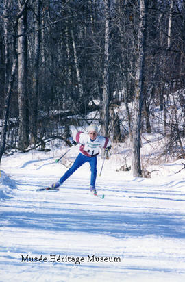 Boy skiing for biathlon event