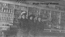 Dormitilde Chevigny, Hermine Paré, and Olivine St. Louis in a store