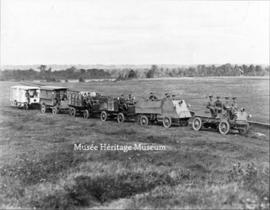Vehicles of the 1st Canadian Automobile Machine Gun Brigade moving to the Rockcliffe Ranges, Ottawa.