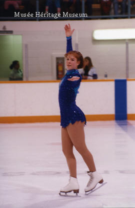 Girl posing during figure skating routine
