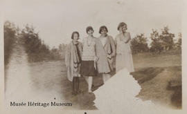 Four women standing outside