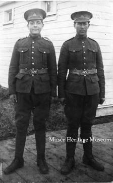 Two military men standing outside