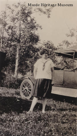 Florence Gagne beside a car