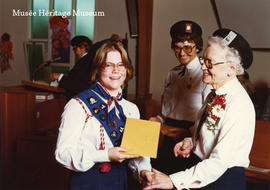Commissioner Mary Beatty presenting Canada Cord for Tamarac Area Guider, 1977 - p. 35