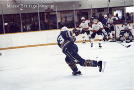 Hockey player shooting the puck