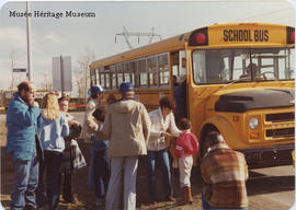 People by school bus