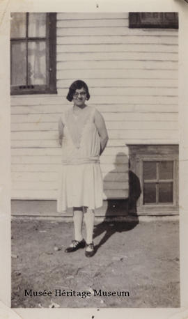 Florence Gagne standing outside a house